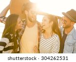 friends  at the beach having... | Shutterstock . vector #304262531