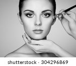 makeup artist applies skintone. ... | Shutterstock . vector #304296869