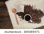 coffee cup and coffee beans | Shutterstock . vector #304385471