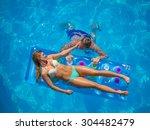 couple outside relaxing in... | Shutterstock . vector #304482479