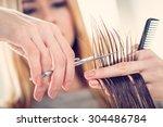 close up of a hairdresser...   Shutterstock . vector #304486784