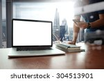 Stock photo designer hand working and smart phone and blank screen laptop on wooden desk in office with london 304513901