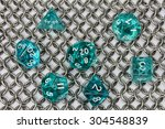 Small photo of green dice set and ringmail