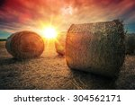 Baled Hay Rolls At Sunset. Hay...