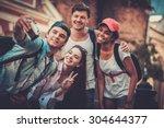 multiracial friends tourists... | Shutterstock . vector #304644377