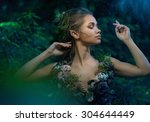 elf woman in a magical forest | Shutterstock . vector #304644449