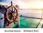 Wooden Wheel On The Ship At...