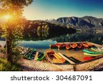 boat on the dock surrounded... | Shutterstock . vector #304687091