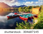 boat on the dock surrounded... | Shutterstock . vector #304687145