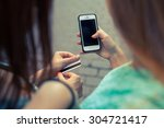 close up of smartphone and... | Shutterstock . vector #304721417
