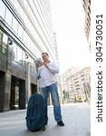 man with blue bag lookig the... | Shutterstock . vector #304730051