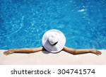 woman in white hat relaxing at... | Shutterstock . vector #304741574