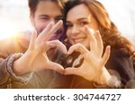 Closeup Of Couple Making Heart...