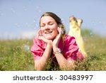 pretty smiling girl relaxing on ... | Shutterstock . vector #30483997