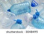 Heap of empty plastic drinking water bottles - stock photo