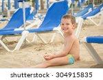 Little Boy On The Beach Among...