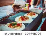 preparation of fajitas  mexican ... | Shutterstock . vector #304948709