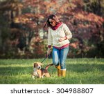 Stock photo woman walk with dog 304988807