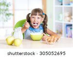 child girl eating healthy food... | Shutterstock . vector #305052695