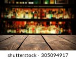 Stock photo retro wooden table in bar 305094917