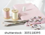 fabric and sewing tools in pink | Shutterstock . vector #305118395