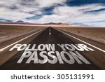 Small photo of Follow Your Passion written on desert road