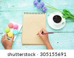 hand holding a pencil to...   Shutterstock . vector #305155691
