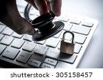 hand holding a stethoscope over ... | Shutterstock . vector #305158457