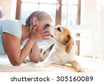 senior woman with dog inside of ... | Shutterstock . vector #305160089