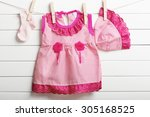 baby clothes hanging on... | Shutterstock . vector #305168525