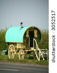 GYPSY CARAVAN ON SIDE OF ROAD - stock photo
