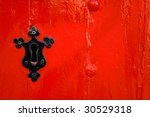 Black Keyhole On Red Wooden Door