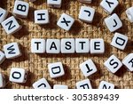 Small photo of TASTE word on white blocks concept