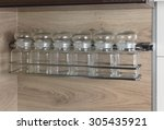 glass spice jars on a shelf.... | Shutterstock . vector #305435921