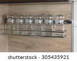 glass spice jars on a shelf.... | Shutterstock . vector #305435921