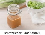 salad dressing with a salad in... | Shutterstock . vector #305450891