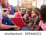 volunteer teacher reading to a... | Shutterstock . vector #305466221