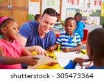 volunteer teacher sitting with... | Shutterstock . vector #305473364