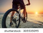 Ride On Bike On The Beach....