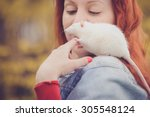 Stock photo home rat is sitting on the girl s shoulder 305548124
