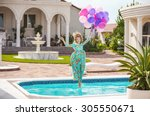 joyful young woman jumping into ... | Shutterstock . vector #305550671