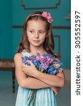little girl in studio with... | Shutterstock . vector #305552597