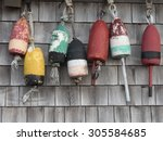 old colorful lobster buoys... | Shutterstock . vector #305584685
