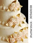 a soft white wedding cake with... | Shutterstock . vector #30560038