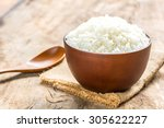 Cooked Rice In Bowl With Spoon...