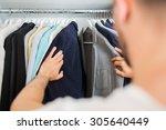unrecognizable man choosing... | Shutterstock . vector #305640449