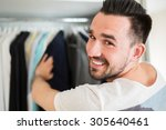 selecting wardrobe in a good... | Shutterstock . vector #305640461