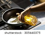 pouring vegetable oil into... | Shutterstock . vector #305660375