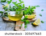 tea with mint and lemon on a...   Shutterstock . vector #305697665