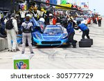Elkhart Lake, Wisconsin USA - August 9, 2015: Road America road course, IMSA. The blue Chevrolet Corvette DP of VisitFlorida.com Racing makes a pit stop for fuel and tires. - stock photo
